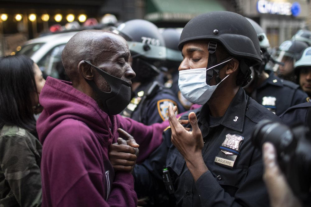 Nation's streets calmest in days; police credit curfews