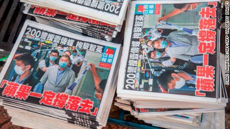 Copies of the Apple Daily newspaper -- paid for by a collection of pro-democracy district councillors -- sit on a cart before being handed out in Hong Kong on August 11, 2020, a day after authorities conducted a search of the newspaper's headquarters.