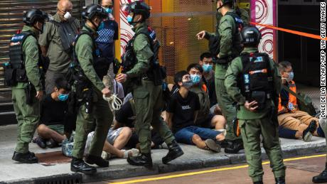 Hong Kong police under fire for tackling 12-year-old during protests