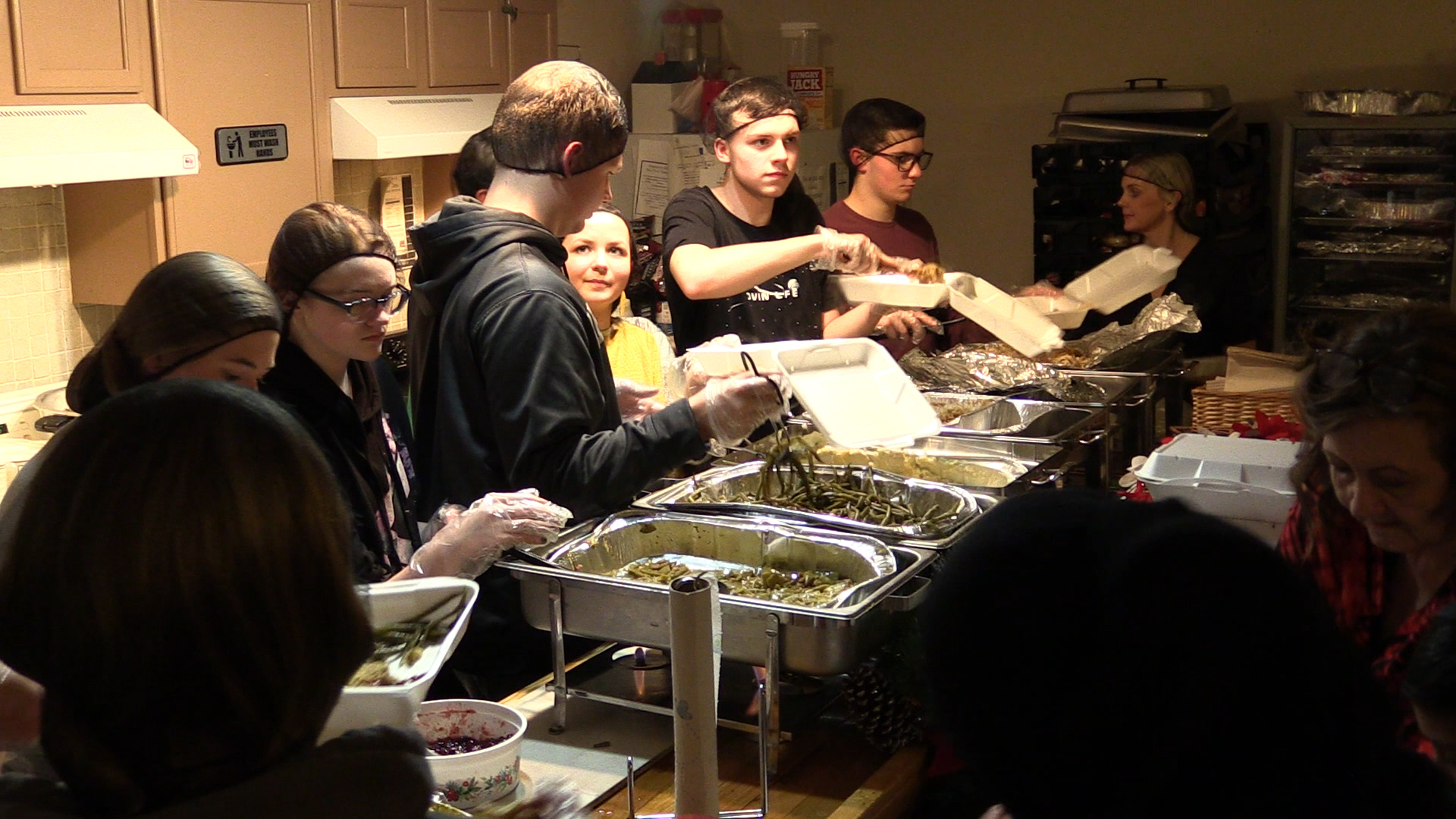 PMC physicians provide meals for those in need