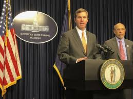 Beshear signs bill to require school officers to be armed
