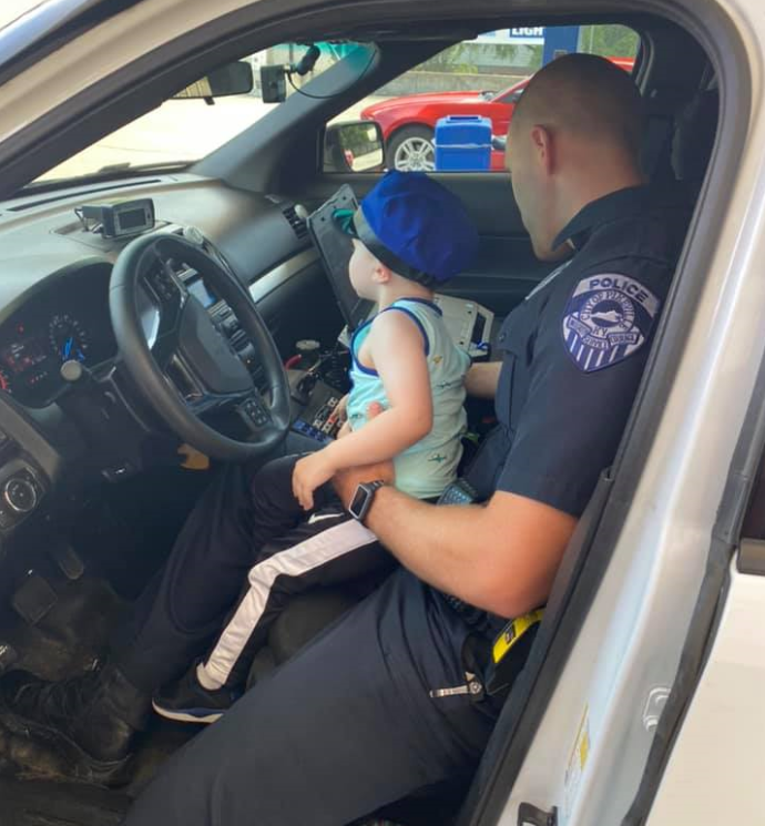 """Local police officer """"recruits"""" young boy for a day"""