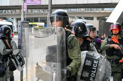 Hong Kong police raid 4 locations tied to protest group