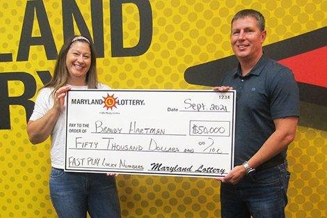 Stop for gas earns Maryland woman a $50,000 lottery prize