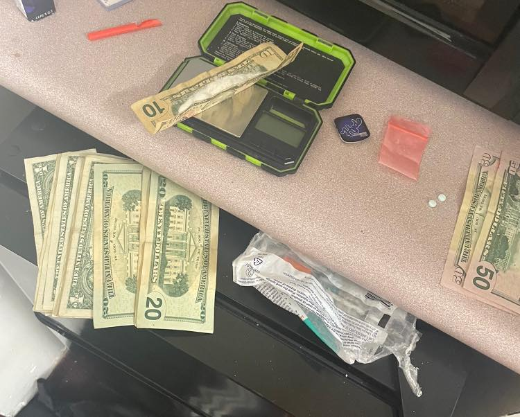 Four charged with trafficking heroin at Alpike Motel