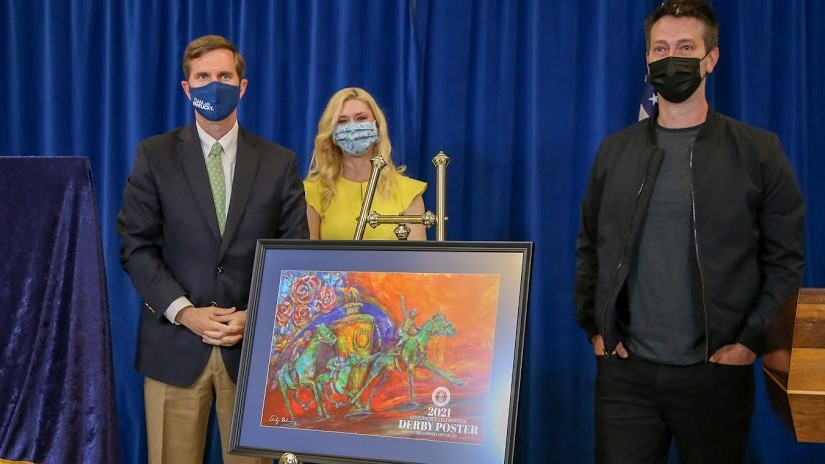 Gov. Andy Beshear and First Lady Britainy Beshear, with Kentucky Derby Festival poster artist Lennon Michalski and his creation.