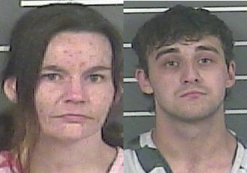 Two arrested after police report finding girls dirty and crying