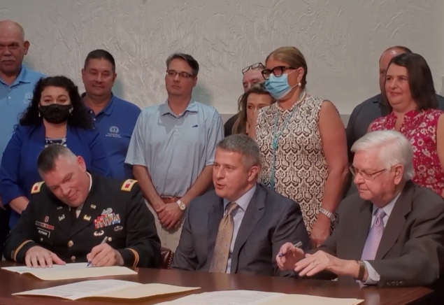 Officials ink floodproofing project for Coal Run