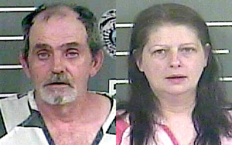 Two charged with stealing from graves