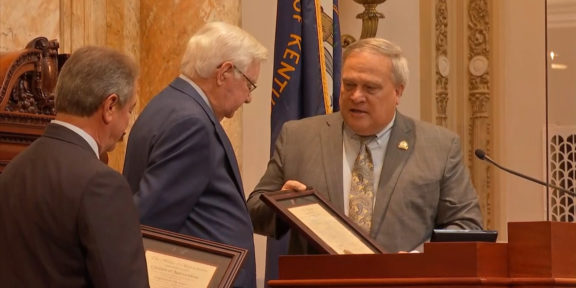 Senate President Robert Stivers, right, and House Speaker David Osborne, left, present U.S. Rep. Hal Rogers with citations honoring his service to the country. Rogers became Kentucky's longest-serving congressman on Thursday.