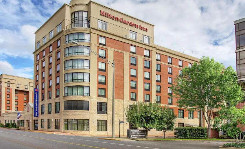 City, college issue statement about hotel purchase