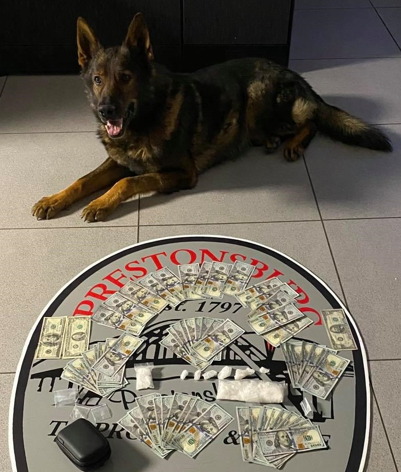 """Police dog """"Davis,"""" with the drugs he discovered inside a motel room."""