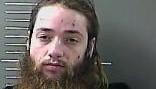 Man charged with walking through neighborhood naked