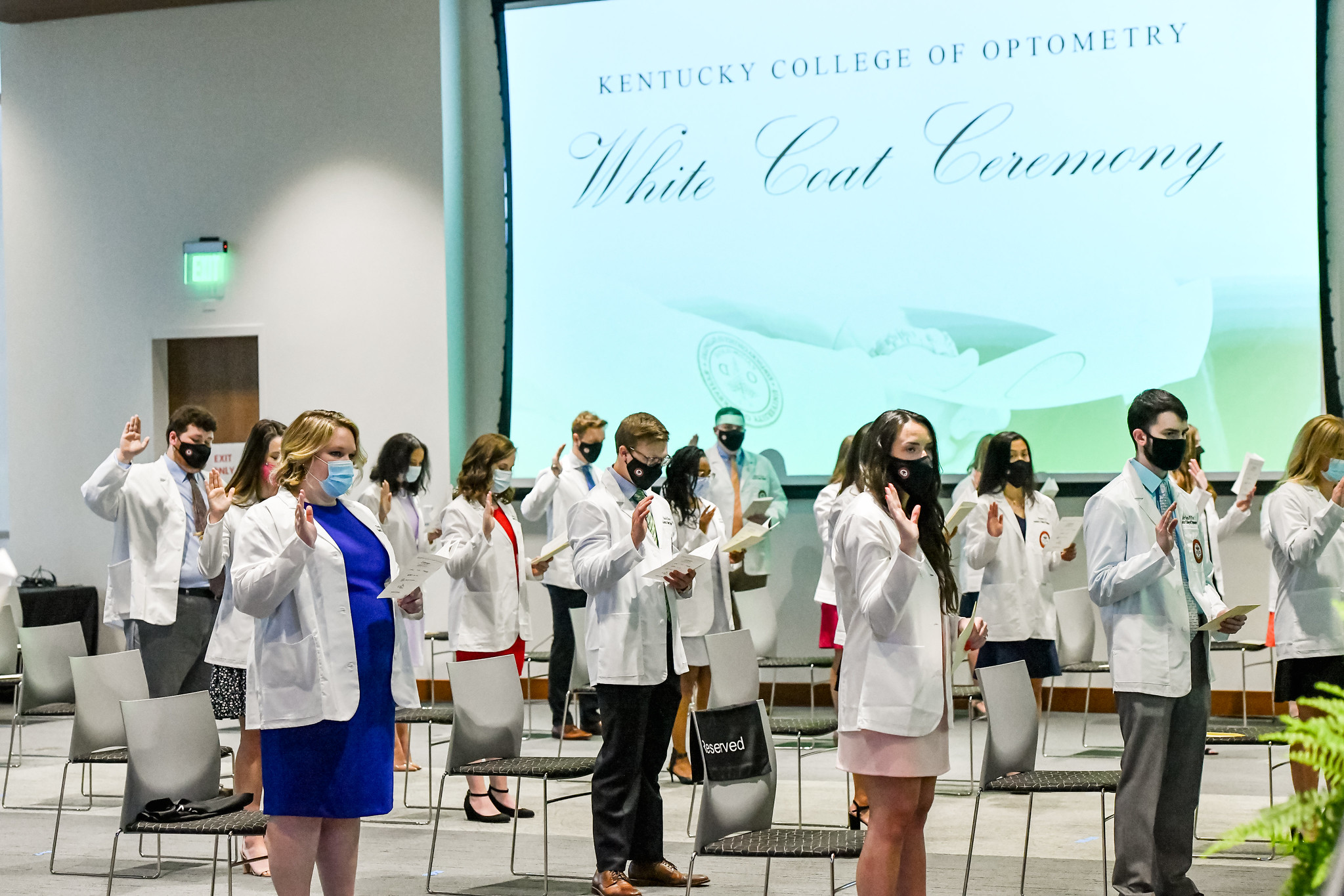 Second-year students at the Kentucky College of Optometry take part in a white-coat ceremony.